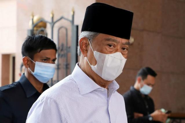 Malaysia's Muhyiddin quits as PM, agrees to caretaker role